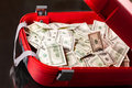 Suitcase With Dollars Stock Photo - 39094930