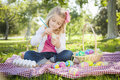 Cute Young Girl Coloring Her Easter Eggs With Paint Brush Stock Image - 39115571