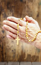 Hands Holding Wooden Rosary Stock Images - 39175144
