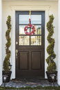 Black Front Door Of Home With Heart Wreath Royalty Free Stock Images - 39176669