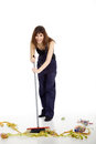 Young Woman Cleans With Broom Royalty Free Stock Photography - 39186787