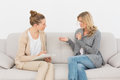 Blonde Woman Talking To Her Therapist On The Couch Royalty Free Stock Photo - 39196235