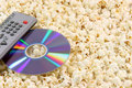 Popcorn Dvd Disc And Remote Stock Images - 3921274