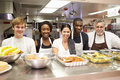 Portrait Of Kitchen Staff In Homeless Shelter Royalty Free Stock Photo - 39220515