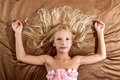 Beautiful Little Girl Dreaming On Bed Stock Image - 39222881