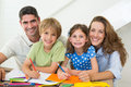 Parents With Children Drawing At Home Stock Photo - 39227140