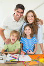Parents With Children Drawing At Table Royalty Free Stock Photos - 39227178