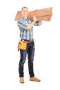 Male Carpenter Carrying Planks Over His Shoulder Royalty Free Stock Photography - 39246407