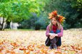 Beautiful Girl In Colorful Autumnal Wreath Royalty Free Stock Image - 39315536