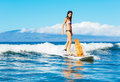 Young Woman Surfing With Her Dog Royalty Free Stock Photo - 39338535
