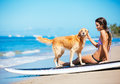 Young Woman Surfing With Her Dog Stock Photo - 39338610
