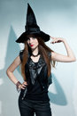 Beautiful Witch Stands And Shows Hat Stock Image - 39339961