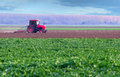 Red Tractor Working On Thre Agricultural Field Royalty Free Stock Photo - 39366605