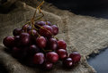Fresh Red Grapes Over Rustic Background Stock Photography - 39375992