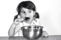 Little Girl Eats Lots Of Chocolate Cream Royalty Free Stock Photography - 39385857