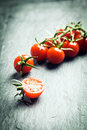 Grape Tomatoes On The Vine Stock Photos - 39392553