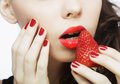 Sexy Lady Holding A Juicy Strawberry Royalty Free Stock Photography - 39411177