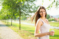 Happy Young Woman Enjoying Coffee In Park Stock Image - 39447791