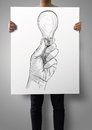 Man Showing Poster Of Hand Drawn Light Bulb Stock Photo - 39460510