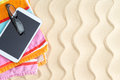 Tablet And Glasses On A Colorful Beach Towel Stock Photos - 39495683