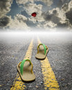 A Pair Of Sandal On The Road With Parachute On The Sky Royalty Free Stock Photos - 39513958