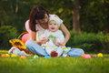 Baby And Mom Are Playing In The Green Park Royalty Free Stock Photography - 39523957
