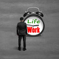 Standing Toward Alarm Clock With Life And Work Face Stock Photo - 39547060