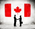 Business Handshake With Canadian Flag Stock Photo - 39551170