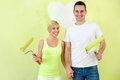 Portrait Of Love Couple With Paint Rollers Stock Photography - 39564222