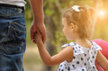 Father And Baby Girl Holding Hand In Hand Stock Images - 39566824