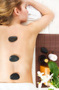Young Woman Getting Hot Stone Massage In Spa Salon Royalty Free Stock Photo - 39569365