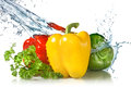 Red, Yellow, Green Pepper And Parsley With Water Royalty Free Stock Photo - 39570785