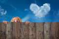Curious Hide Woman / Girl, Cloud Heart Shape, Blue Sky Background Royalty Free Stock Image - 39611386