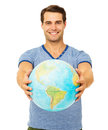 Happy Young Man Showing Globe Royalty Free Stock Photography - 39620427