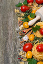 Pasta, Spices, Herbs And Tomatoes On A Wooden Background Royalty Free Stock Photo - 39624315