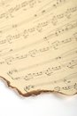 Part Of Old Burnt Music Sheet On Vintage Paper And White Background Stock Image - 39631121