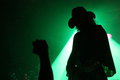Silhouette Of A Guitarist On Stage With A Cowboy Hat With Fan S Fist In Front Of Green Reflector Stock Photo - 39635070