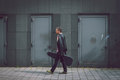 Man In Short Sleeve Shirt Walking With Guitar Case Royalty Free Stock Images - 39649329