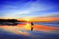 Surfer In Beach At Sunset Stock Photos - 39659603