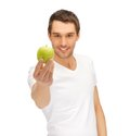 Man In White Shirt With Green Apple Royalty Free Stock Photos - 39715218