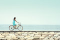 Woman Having Fun Riding Bicycle At The Beach Stock Photos - 39715593