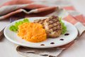 Pork Steak Fried On Grill With Mashed Sweet Potatoes, Tasty Stock Image - 39772171