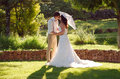 Bride And Groom Kissing In Garden Wedding Stock Images - 39776424