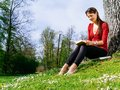Woman Reading Outside In Spring Stock Image - 39777831