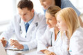 Group Of Doctors Looking At Laptop Computer Stock Photos - 39782633
