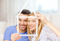 Smiling Couple With House From Measuring Tape Stock Image - 39782721