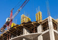Tall Building Under Construction With Crane Stock Photography - 39787572