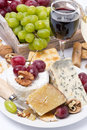 Assortment Of Cheeses, Glass Of Red Wine, Grapes And Crackers Royalty Free Stock Photos - 39796758