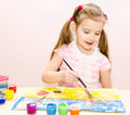 Cute Smiling Little Girl Drawing With Paint And Paintbrush Stock Image - 39805861