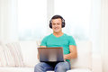 Smiling Man With Laptop And Headphones At Home Royalty Free Stock Image - 39808646